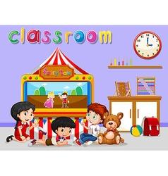 Children watching puppet in classroom vector image