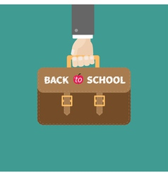 hand holding brown schoolbag briefcase flat vector image