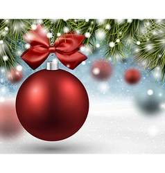 Red bauble on spruce branches vector image