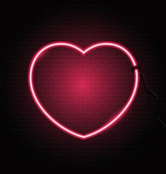 neon heart on brick wall texture vector image