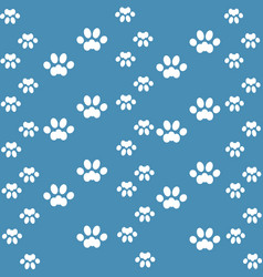 white cats paw on an blue background vector image