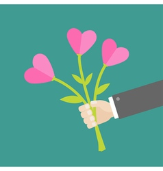Businessman hand holding bouquet of heart flowers vector image