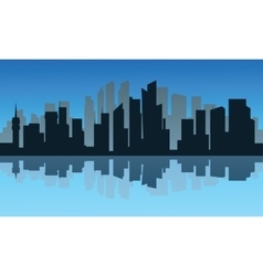 Silhouette of city and reflection at night vector image