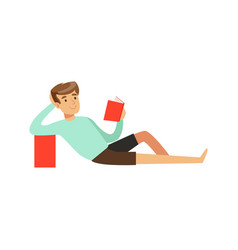 young man sitting on the floor and reading a book vector image vector image