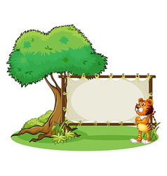A tiger beside the empty framed signboard vector