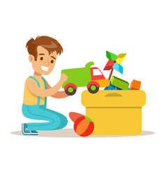 Little boy and many toys in a box part of vector