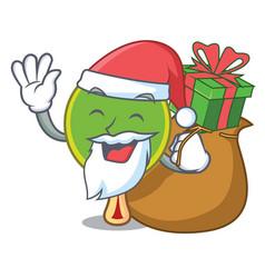 Santa with gift ping pong racket mascot cartoon vector