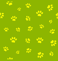 seamless pattern paws on green vector image