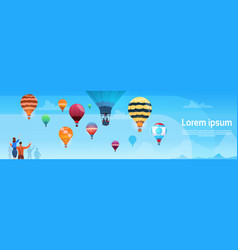 people looking at colorful air balloons flying in vector image