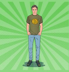 Pop art man wearing in t-shirt with bitcoin print vector