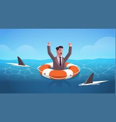 Businessman raising hands inside lifebuoy in water vector