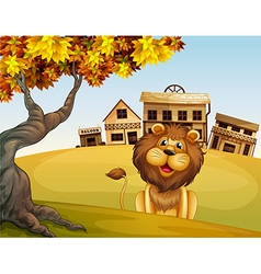 A lion in front of a wooden house vector image