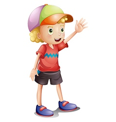 A boy wearing a colorful cap vector image