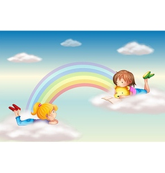 Two girls along the rainbow vector image vector image