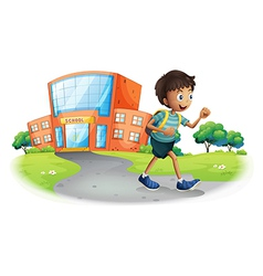 A boy going home from school vector image vector image
