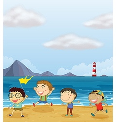 Four boys playing at the beach vector image