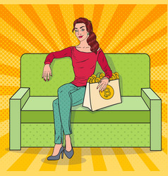 Pop art woman with shopping bag full of bitcoin vector