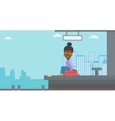 Woman sitting on suitcase at the train station vector image