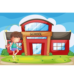 A girl playing in front of the school vector image vector image