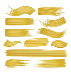 Golden brushstrokes set on white vector