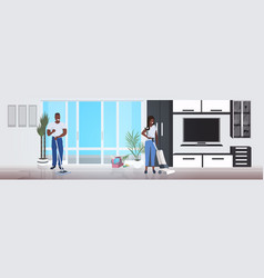Couple man woman using mop and vacuum cleaner vector