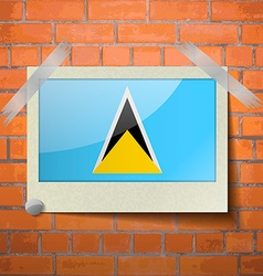 Flags Saint Lucia scotch taped to a red brick wall vector