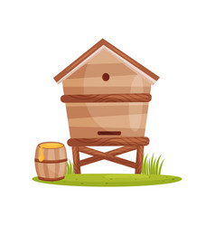 large wooden beehive and barrel with sweet honey vector image