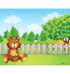 A bear holding a honey at the backyard vector