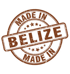 made in belize brown grunge round stamp vector image