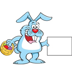 Cartoon Easter bunny holding a sign vector image