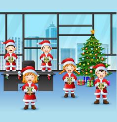 Cartoon of group children in santa singing christm vector