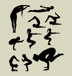 Female yoga silhouettes vector image