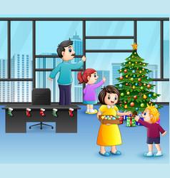 Cartoon happy family decorating a christmas tre vector