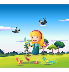 A girl surrounded by birds at the hill vector