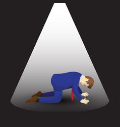 Businessman kneeling under spotlight vector