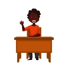 Clever school boy sitting at the desk holding a vector