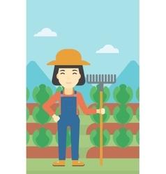 Female farmer with rake vector