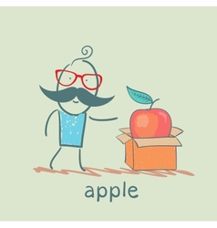 Man opens a box with an apple vector