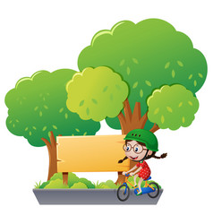 Wooden sign and girl riding bike in park vector