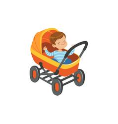 Cute little boy sitting in an orange baby pram vector
