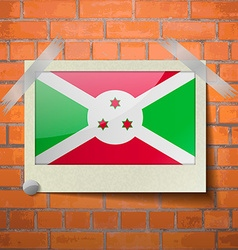 Flags Burundi scotch taped to a red brick wall vector