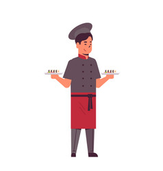 Male asian chef cook holding trays with fresh vector
