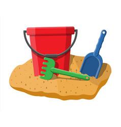 plastic bucket with rake and shovel vector image