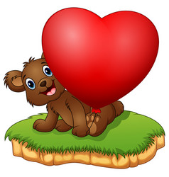 teddy bear sitting with holding the valentine ball vector image