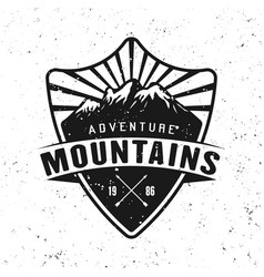 Traveling adventure badge with mountains vector