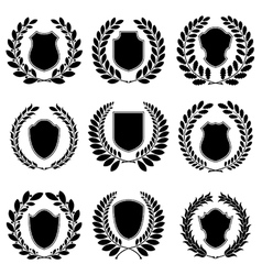 Set of heraldic black emblems vector image