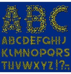Swirly golden alphabet vector image vector image