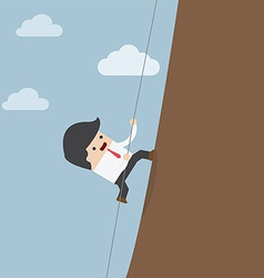 Businessman climbing on the rocks vector