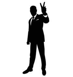 silhouette of a man showing a gesture of victory vector image
