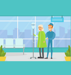doctor supporting elderly female patient standing vector image